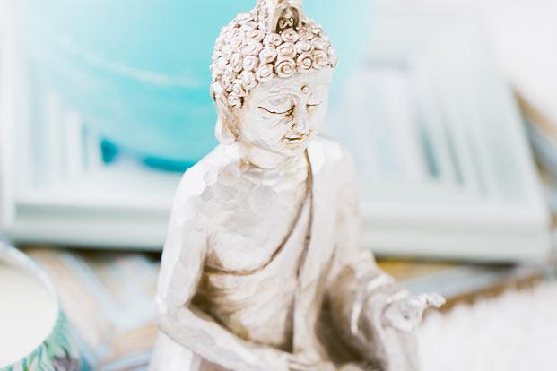 happy buddha figurine meditation